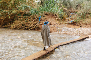 Berber man walking outside of Tinghir, Morocco