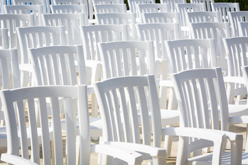 white chairs for watching performances on stage.