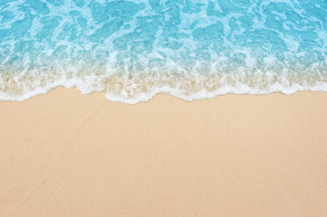 Spoed Fotobehang Strand beautiful sandy beach and soft blue ocean wave