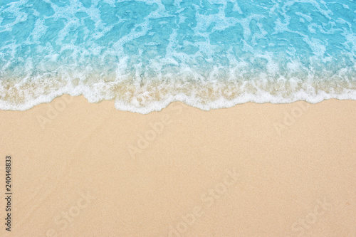 Wall mural beautiful sandy beach and soft blue ocean wave