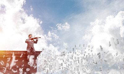 Handsome businessman play his melody and symbols fly around in air Wall mural