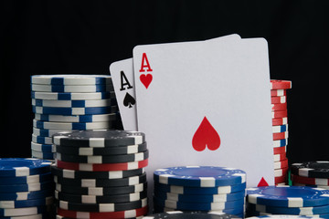 two aces, close-up, surrounded by a big bet in a casino gambling, on a black background
