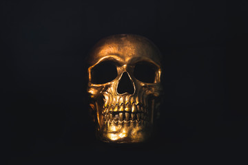 Gold skull on black background