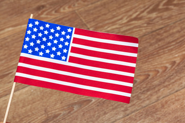 flag of the United States of America on wooden background. USA holiday of Veterans, Memorial, Independence and Labor Day.