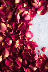rose petals on marble flatlay - wedding, holiday and floral background styled concept