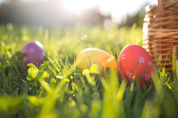 Easter eggs in a basket on the grass on a Sunny spring day close-up