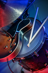 electric guitar, drum with sticks and plate