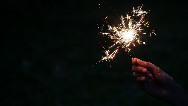 Happy new year with hand hold burning bengal light