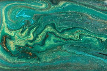 Gold marbling texture design. Green and golden marble pattern. Fluid art.