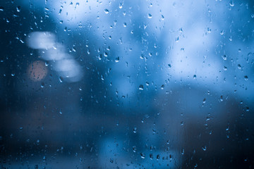 Drops on the glass, background, rain outside the window, cover, picture and photo for you. warm colors.