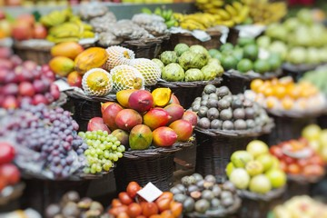 Market stall with tropical fruits and vegetables. Selective Focus.