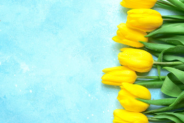 Celebrate background with bouquet of yellow tulips.Top view with copy space.