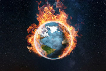 The globe is on fire, global warming, the average temperature on earth is rising. The concept of disaster. This image elements furnished by NASA