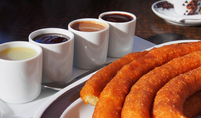 Typical Spanish snack churros are deep-fried pastries and served with hot chocolate everywhere in Spain. Churros con chocolate is a classic Spanish breakfast