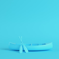 Canoe with paddles on bright blue background in pastel colors