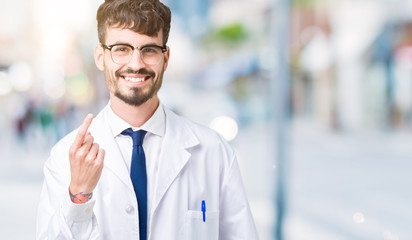 Young professional scientist man wearing white coat over isolated background Beckoning come here gesture with hand inviting happy and smiling