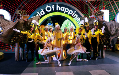 Performers pose for a photo before their perfomance as they celebrate Christmas in Bangkok