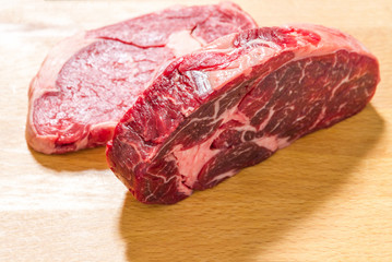 Two raw dry aged entrecote, top view
