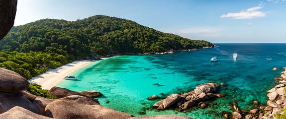 Panorama of a beautiful tropical sandy beach and lush green foliage on a tropical island (Koh Similan) Wall mural