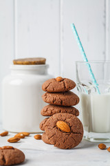 Chocolate cookies with almonds on white background. Vegan dessert concept.