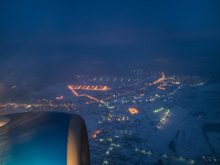view of airplane turbine over snow covered village