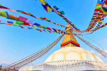 Colourful Tibetan Prayer Flags and Boudhanath Stupa in Kathmandu Valley