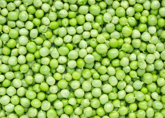 Green peas background. Fresh raw peas.