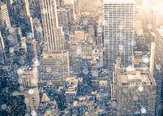 Wall Mural - New York City Manhattan skyscraper buildings with snowflakes falling during winter snow storm