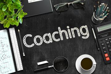 Coaching - Text on Black Chalkboard. 3D Rendering.