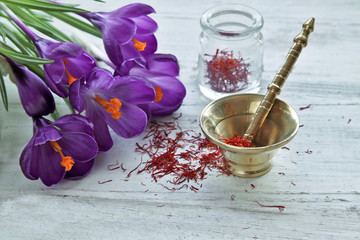 Saffron with crocus flowers on table