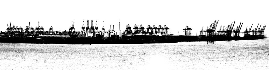 Silhouette of cranes in Hamburg Harbor, Germany. Panorama  in black and white.