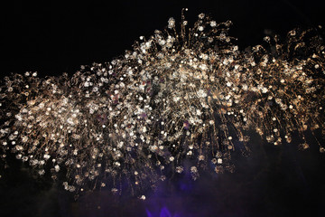 Golden fireworks in the sky with unusual sparks