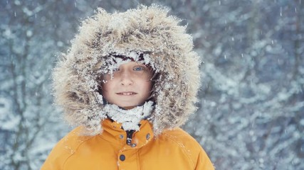 414ed60f02756 0:15 Boy dressed in Warm Hooded Casual Parka Jacket Outerwear looking into  camera face portrait with falling