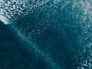 Aerial view beautiful of sea waves from drone. Stock image picture of blue color ocean water, wave, sea surface. Top view on turquoise waves, clear water surface texture. Top view, amazing nature