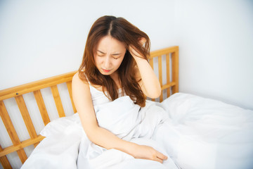 Woman Suffer From Headache On Bed