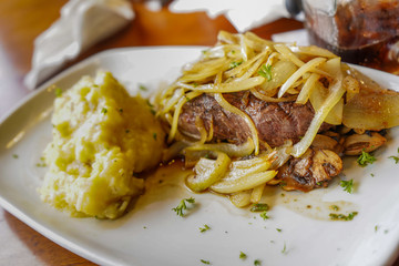 Delicious steak with onions and mashed potatoes