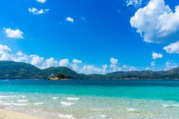 Greece, Zakynthos, Green mountainous nature landscape behind caribbean azure blue beach