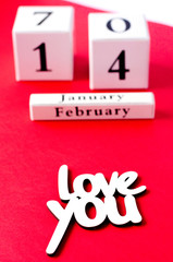 Calendar Happy Valentine's Day on a red background.