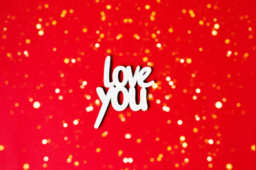 The word love you on a red background with lights.