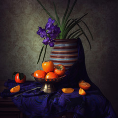 Still life with blue orchid and persimmon