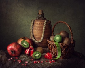 Still life with kiwi and pomegranates