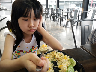 Little Girl Feels Lack of appetite with Food.