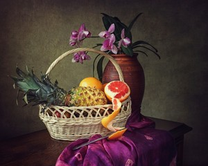 Still life with fruits and orchid flowers