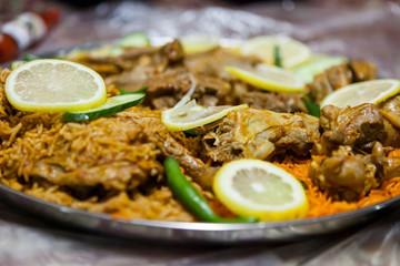 Lamb salona and chicken mandi served on the floor at an Emirati restaurant in Dubai, United Arab Emirates