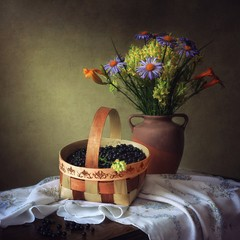 Still life with ripe blueberry and bouquet flowers