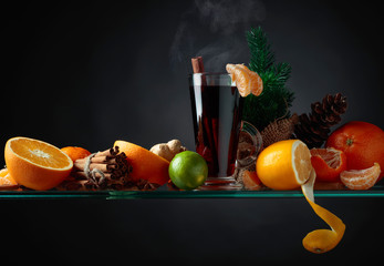 Mulled wine hot drink with citrus and spices.