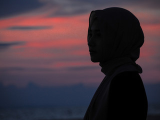 Shining women At dusk at sea (Night Picture)