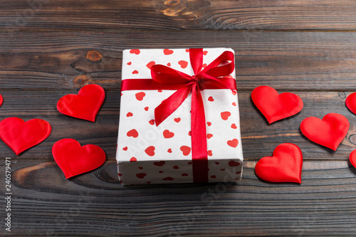 Valentine Or Other Holiday Handmade Present In Paper With Red Hearts