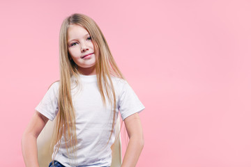 Portrait of a beautiful blonde girl over pink background.