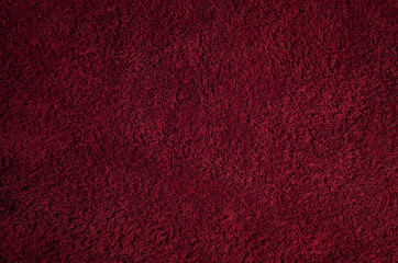 Detailed abstract dark red textural textile background.